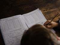 Child completing maths homework